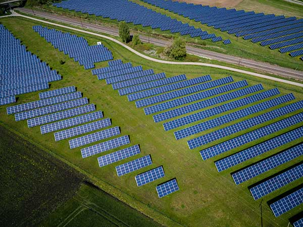 Renewable Energy   Cost vs Rewards    Image of Solar Energy Field