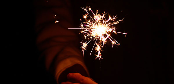 Fireworks Safety | Safe Alterative Ideas - person holding sparkler