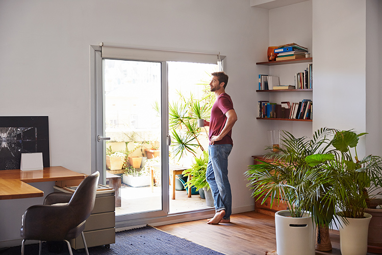 Save on Your Electric Bill | Image of Man admiring sun