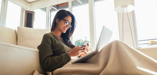 Winter Energy Saving Tips | Girl at home saving energy with blanket