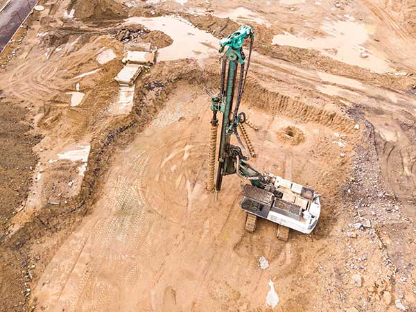 Natural Gas Extraction | image of industrial quarry drill
