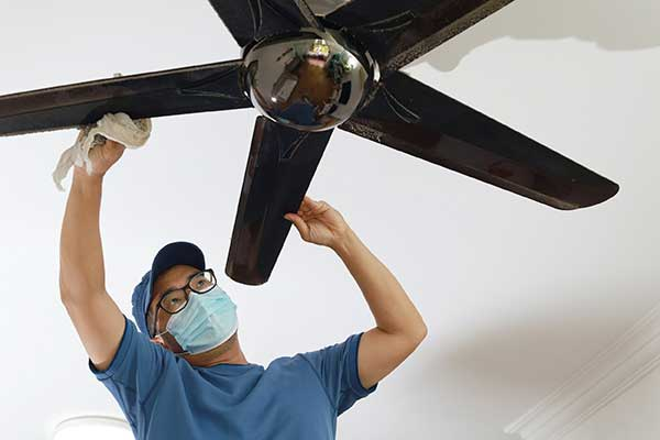 Ceiling Fan Shopping Tips | Man installing