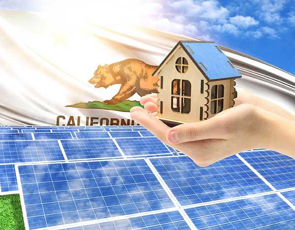 Deregulated Energy Markets Hand holding house over solar panels