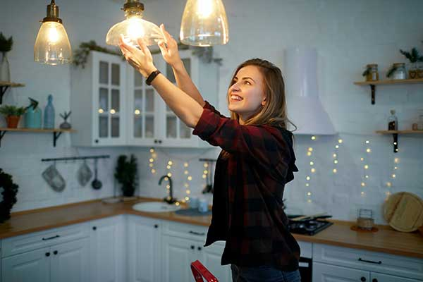 Energy-Saving Light Bulbs | Lady changing bulbs photo