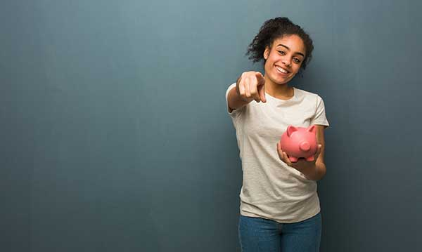 Kilowatts Learning | image of young girl holding piggy bank