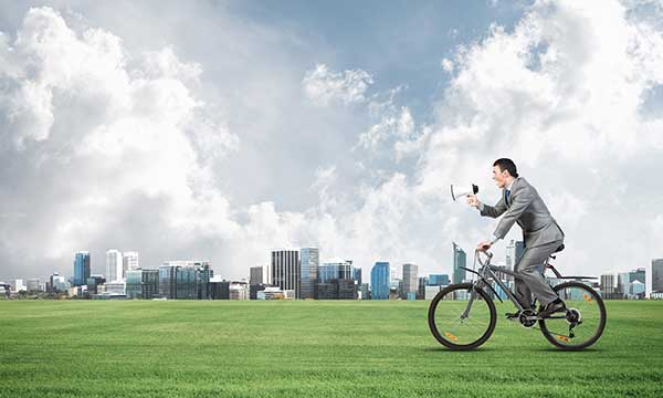 Green Energy Plans | Humor Photo Man on Bike