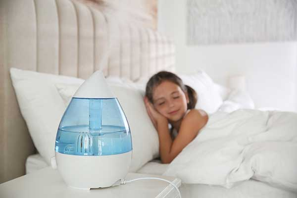 Humidifier Producing Mist   Child in Bed