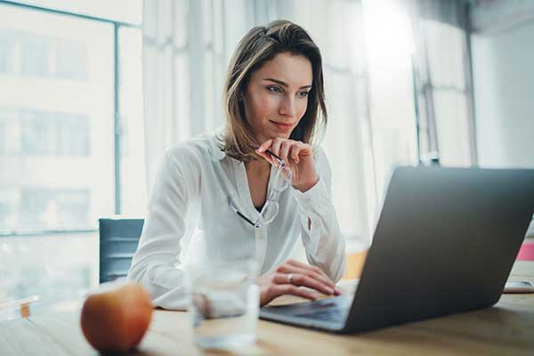 Energy Plans under Review | Just Energy - Woman at Laptop